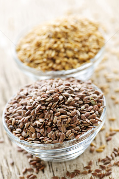 Brown and golden flax seed Stock photo © elenaphoto