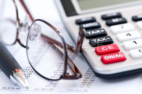 Stock photo: Tax calculator pen and glasses