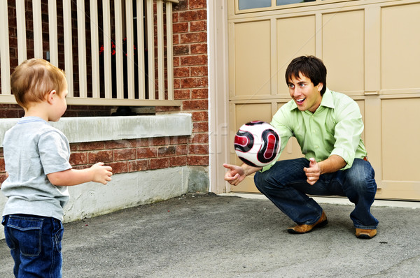 Father and son playing soccer Stock photo © elenaphoto