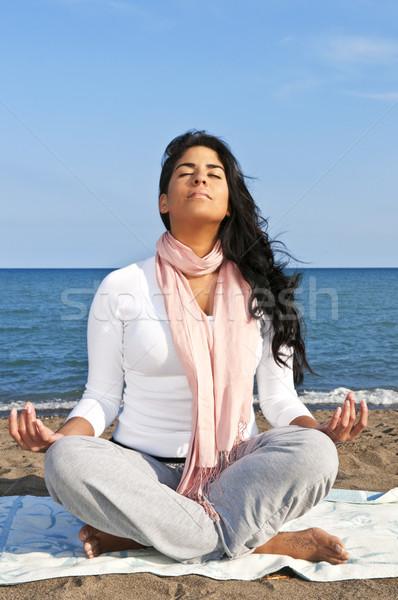 Young native american woman meditating Stock photo © elenaphoto