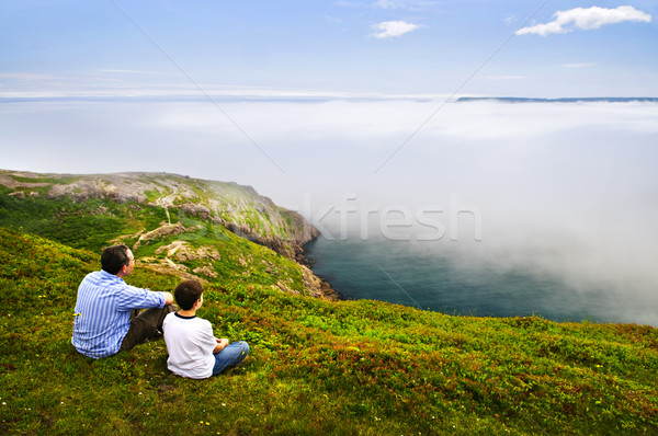 Father and son at ocean coast Stock photo © elenaphoto