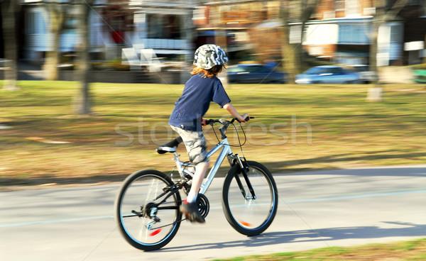 Boy riding a bike Stock photo © elenaphoto
