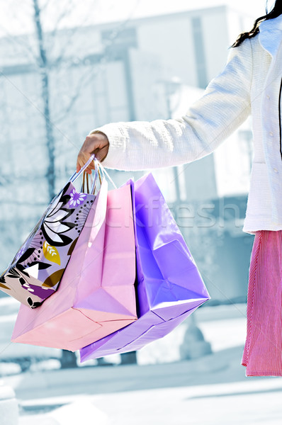 Woman holding shopping bags Stock photo © elenaphoto