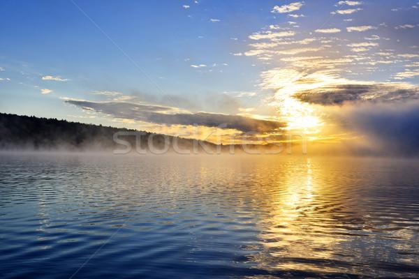 Sunrise on foggy lake Stock photo © elenaphoto