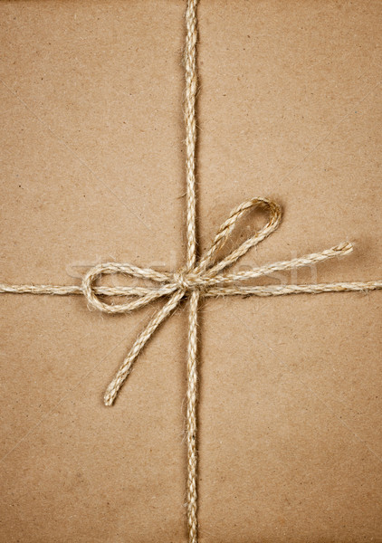Package in brown paper tied with string Stock photo © elenaphoto