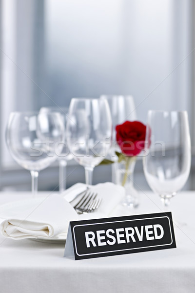 Romantic dinner setting with reserved sign Stock photo © elenaphoto