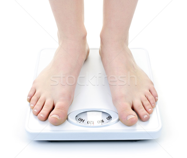 Feet on bathroom scale Stock photo © elenaphoto