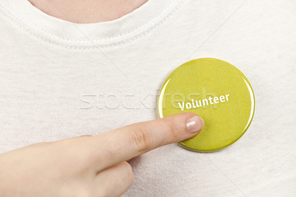 Hand pointing to volunteer button Stock photo © elenaphoto
