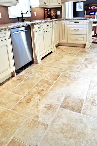 Tile floor in modern kitchen Stock photo © elenaphoto