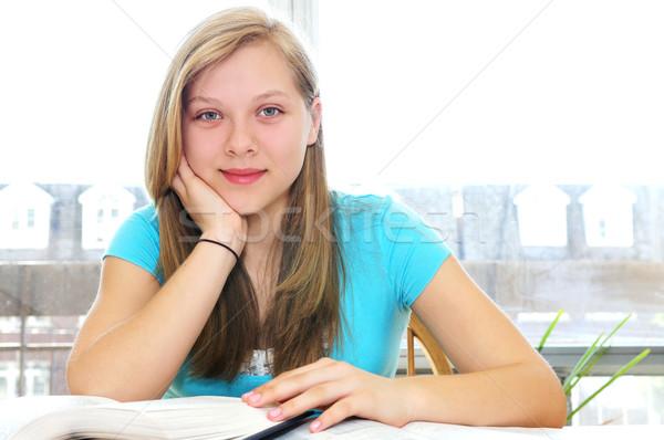 Happy teenage girl studying Stock photo © elenaphoto