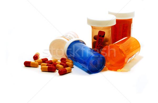 Pilules blanche plastique pilule fond bleu Photo stock © elenaphoto