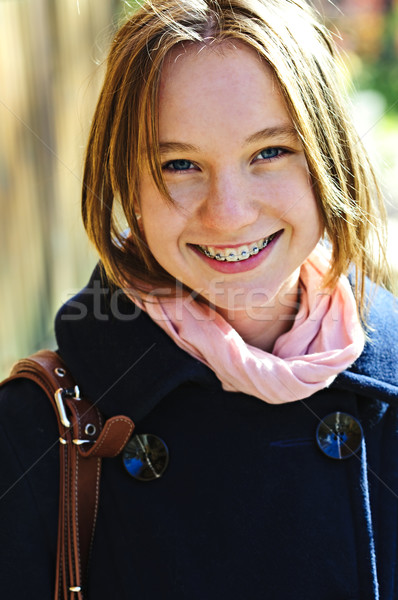 Heureux adolescente manteau portrait souriant Photo stock © elenaphoto