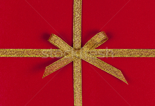 Red gift with gold ribbon Stock photo © elenaphoto