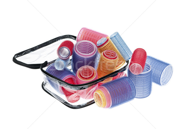Case of hair rollers on white Stock photo © elenaphoto