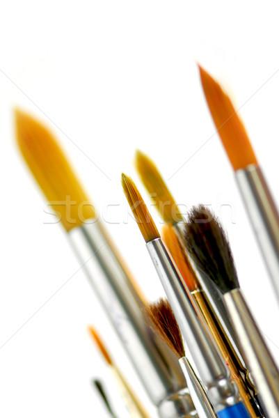 Pennelli primo piano bianco vernice arte pittura Foto d'archivio © elenaphoto