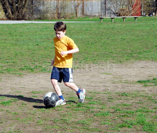 Boy playing soccer Stock photo © elenaphoto
