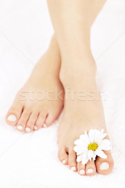 Női láb pedikűr puha virágok közelkép Stock fotó © elenaphoto