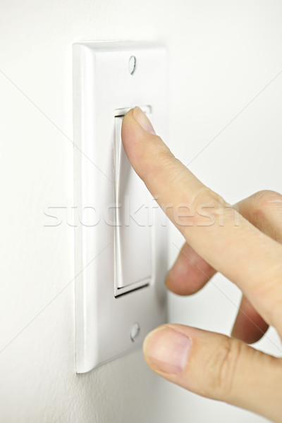 Af lichtschakelaar vinger witte licht plaat Stockfoto © elenaphoto