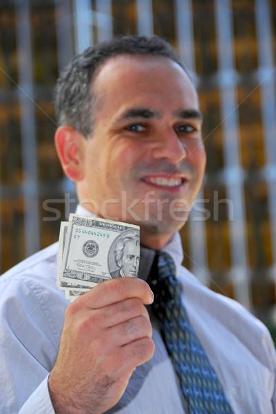 Businessman hold money Stock photo © elenaphoto