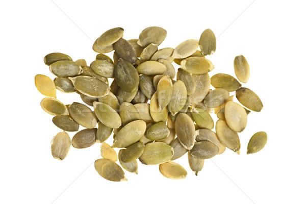 Pumpkin seeds on white Stock photo © elenaphoto
