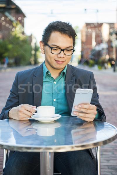 Fiatal ázsiai férfi szabadtér kávézó sikeres Stock fotó © elenaphoto