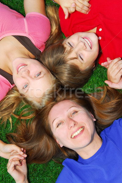 Stock photo: Family lying down on grass