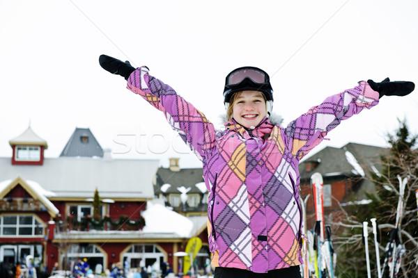 Boldog lány karok a magasban üdülőhely boldog tinilány sí Stock fotó © elenaphoto
