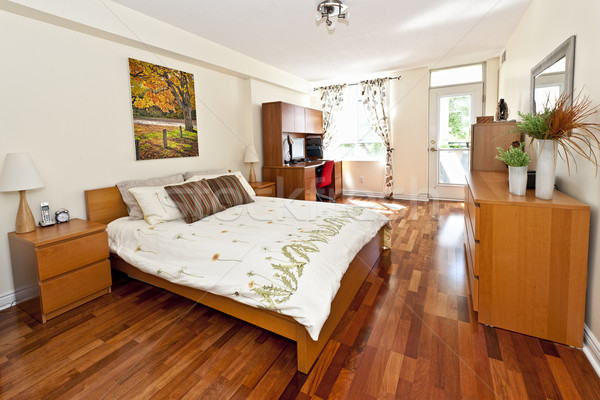 Stock photo: Bedroom interior with hardwood floor