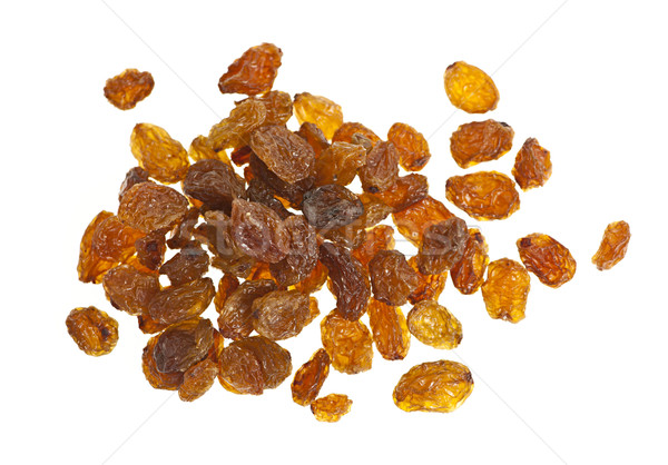 Pile of yellow sultana raisins on white Stock photo © elenaphoto