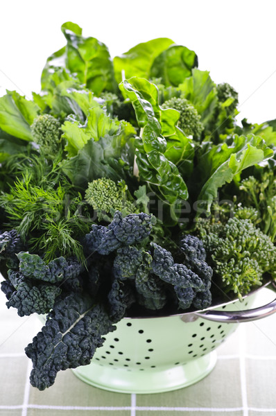 Dark green leafy vegetables in colander Stock photo © elenaphoto