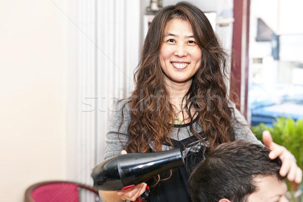 Haj stylist dolgozik mosolyog hajszárító szalon Stock fotó © elenaphoto