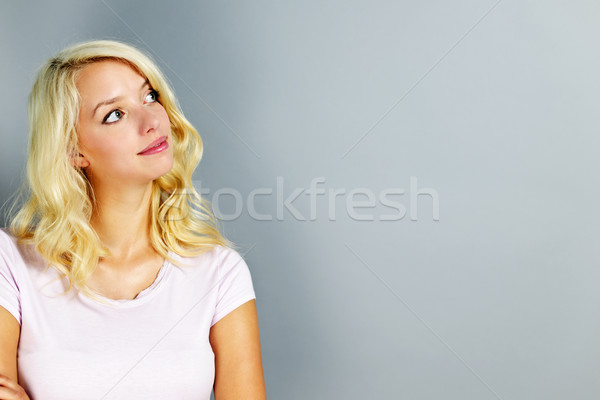 Young woman looking up Stock photo © elenaphoto