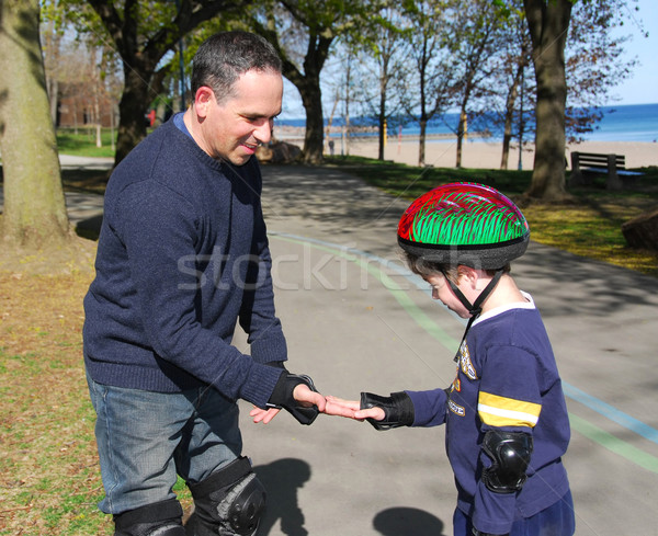 Father and son rollerblading Stock photo © elenaphoto