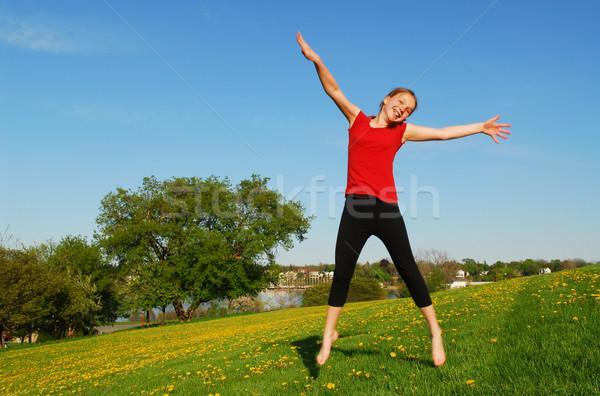 Young girl jumping Stock photo © elenaphoto