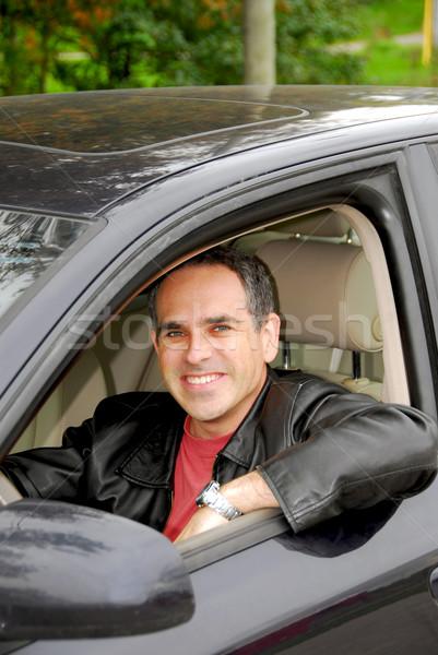 Homem carro sorridente feliz olhando janela Foto stock © elenaphoto
