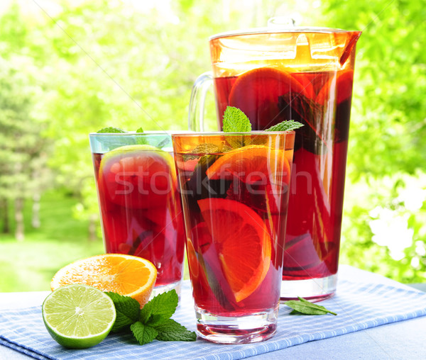 Fruit punch in pitcher and glasses Stock photo © elenaphoto