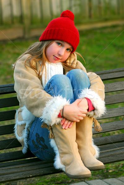 Girl on bench Stock photo © elenaphoto