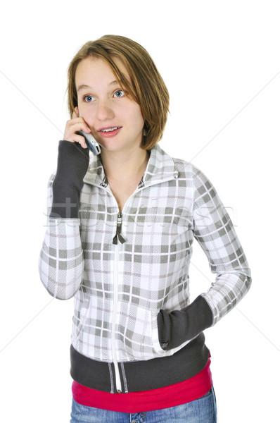 Adolescente parler téléphone téléphone portable isolé blanche Photo stock © elenaphoto