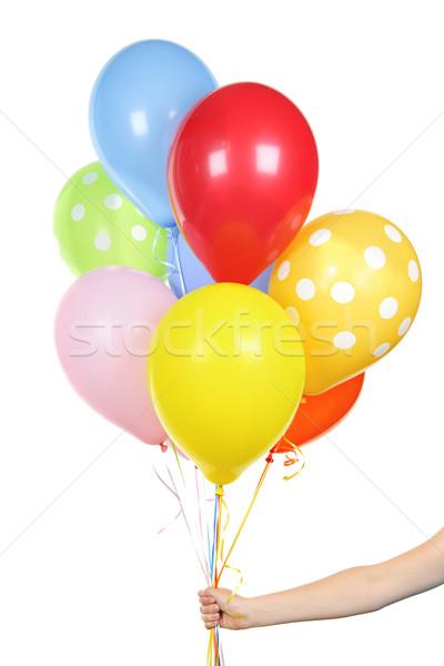 Main ballons blanche coloré hélium Photo stock © elenaphoto