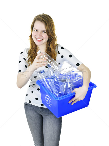 Young woman with recycling box Stock photo © elenaphoto