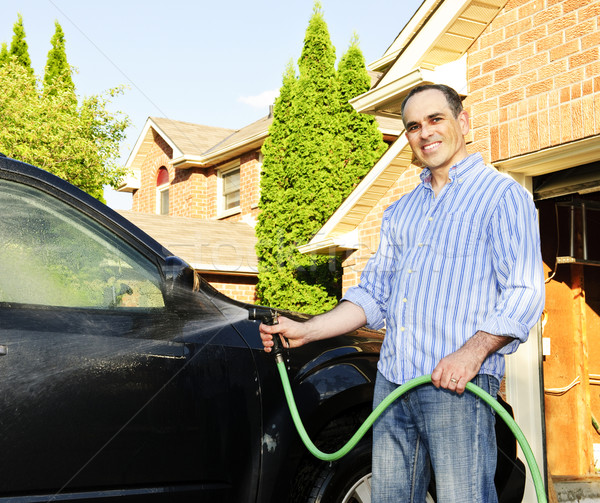 Man washing car on driveway Stock photo © elenaphoto