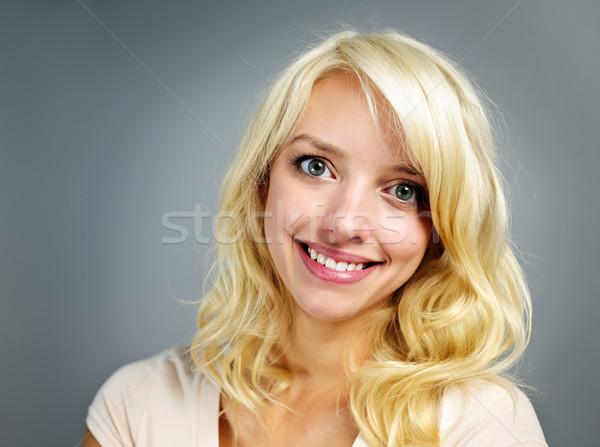 Young smiling woman portrait Stock photo © elenaphoto