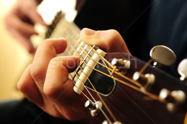 Man playing a guitar Stock photo © elenaphoto