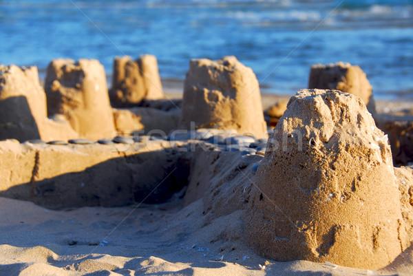 Homokvár tengerpart épület tenger kék utazás Stock fotó © elenaphoto