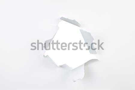 Trou papier déchirée blanche fiche larme Photo stock © elenaphoto