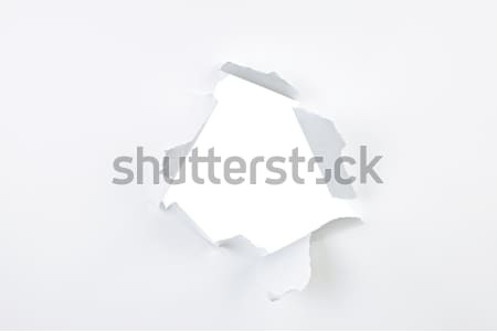 Hole in paper Stock photo © elenaphoto