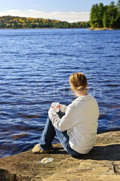 Woman relaxing at beautiful lake Stock photo © elenaphoto