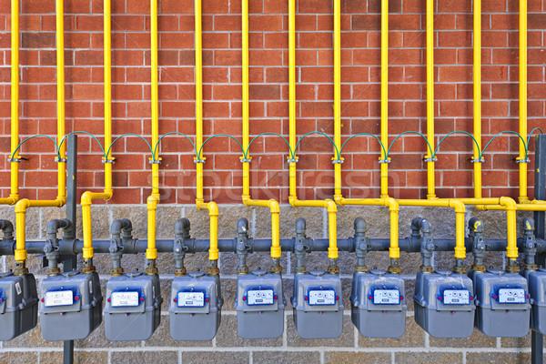 Gazu murem rząd gaz ziemny żółty rur Zdjęcia stock © elenaphoto
