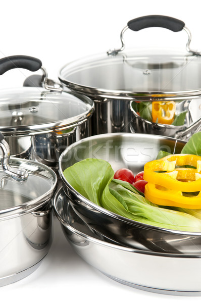 Stainless steel pots and pans with vegetables Stock photo © elenaphoto
