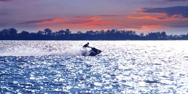 Férfi jet ski naplemente égbolt nap sport Stock fotó © elenaphoto